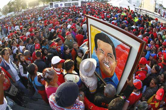 Supporters of Venezuela's late President Hugo Chavez wait for a chance to view his body at the military academy in Caracas March 8, 2013. Chavez will be embalmed and put on display 