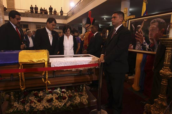 Ecuador's President Rafael Correa (2nd L) views the body of late Venezuelan President Hugo Chavez as he visits the wake with his wife Ann Malherbe (R) and Venezuela's acting President Nicolas Maduro (L) at the military academy in Caracas March 7, 2013, in this picture provided by the Miraflores Palace. Chavez will be embalmed and put on display