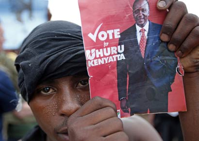 A supporter of presidential candidate Uhuru Kenyatta celebrates on the outskirts of Nairobi.