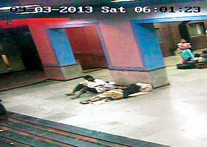 CCTV camera footage shows an unidentified man lifting the baby away from his mother's side