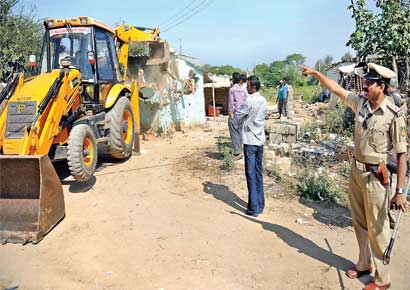 Demolition of encroachments by BMTF.