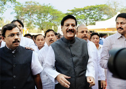 Chief minister Prithviraj Chavan along with opposition leader Vinod Tawde (left) at Vidhan Bhavan during the state assembly session on Tuesday.