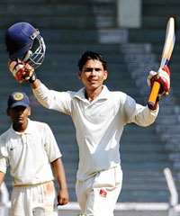 Shoeb Khan celebrates his double century during the Giles Shield final at Brabourne Stadium on Tuesday.