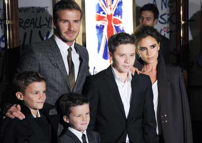 David and Victoria Beckham with sons Romeo, Cruz and Brooklyn at an event in London.