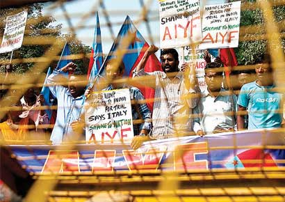 Left-party activists hold placards and shout slogans during a protest near the Italian Embassy in New Delhi on Wednesday.