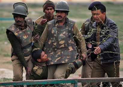 CRPF jawans carry their injured colleague to a hospital after their camp was attacked by two suicide bombers. 