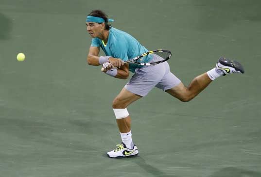Rafael Nadal of Spain returns a shot against Roger Federer of Switzerland during their men's singles quarterfinal match at the BNP Paribas Open ATP tennis tournament in Indian Wells, California, March 14, 2013.