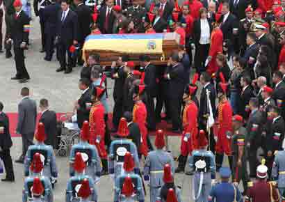Pallbearers carry the coffin of Venezuela's late President Hugo Chavez to a hearse prior to a funeral parade in Caracas March 15, 2013, in this picture provided by the Miraflores Palace.