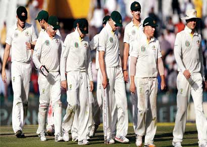 The Australian team walks back after losing the third Test against India by six wickets.