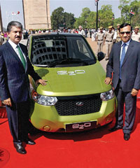 (From left) Anand Mahindra, chairman and managing director of Mahindra and Mahindra and Pawan Goenka, president, automotive and farm equipment sectors, at the launch of Mahindra Reva e2o in New Delhi on Monday.