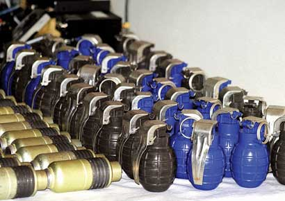 Police display arms and ammunition recovered from one of the arrested militants in Srinagar on Tuesday.