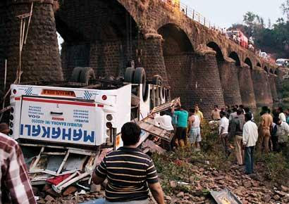 People rescue trapped passengers of the ill-fated Mahakali Travels bus that fell off a bridge over Jagbudi river in Khed area of Ratnagiri district on the Mumbai-Goa highway on Tuesday.