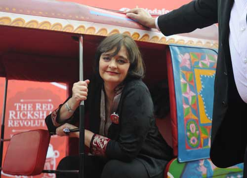 Cherie Blair poses in a rickshaw