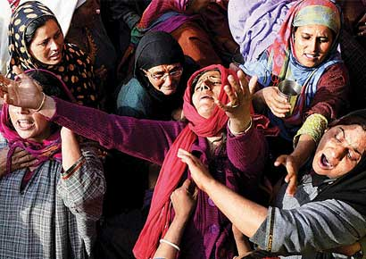 Relatives mourn the killing of Suhail Ahmed Sofi (inset) in Sopore on Wednesday