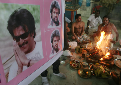 Fans of Tamil superstar Rajinikanth, who has been admitted to the intensive care unit of a Chennai hospital following a recurrent respiratory infection and gastro-intestinal problems, pray for his speedy recovery at a havan in Dharavi on Thursday, May 19, 2011.