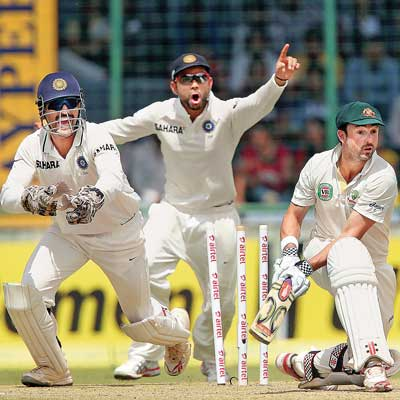 Australian opener Ed Cowan is shocked after R Ashwin (not in pic) bowls him round his legs on Day One of the fourth and final Test in New Delhi on Friday.
