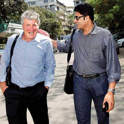 Anil Kumble catches up with former India coach John Wright at the Cricket Centre in Mumbai on Friday.