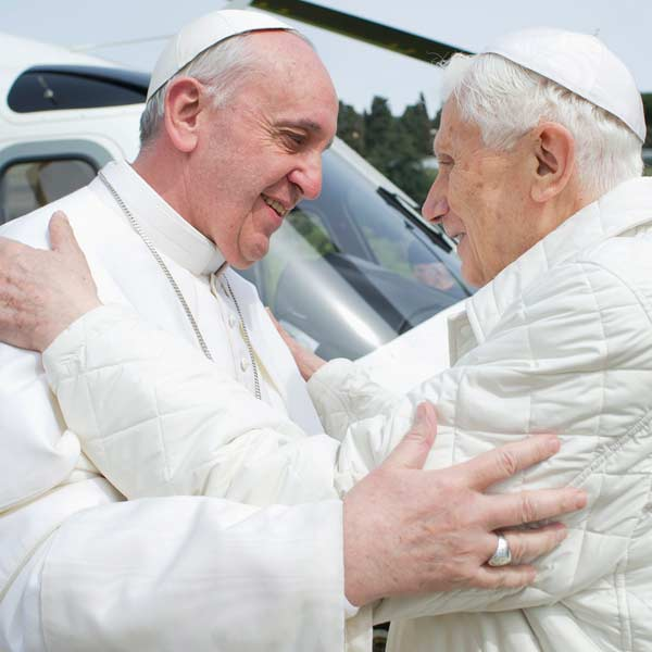 Pope Francis (L) embraces Pope Emeritus Benedict XVI as he arrives at the Castel Gandolfo summer residence on March 23, 2013. Pope Francis travelled by helicopter from the Vatican to Castel Gandolfo for a private meeting with former Pope Benedict XVI. 