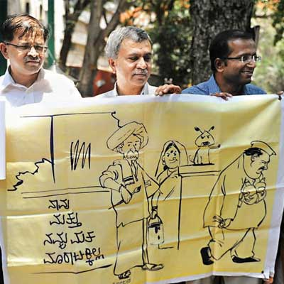 Members of Karnataka Election watch at a press meet in Bangalore on Friday.