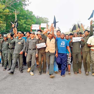 Forest guards and residents carrying placards and shouting 'Chellam Go Back' protest scientist's entry into Gir.