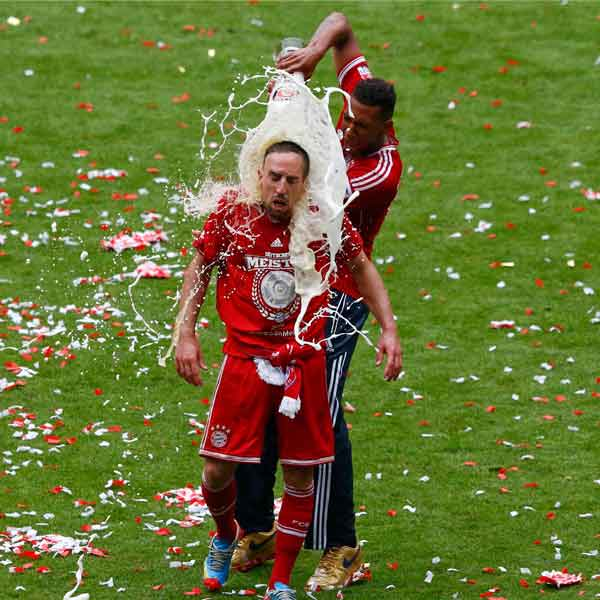 Ribery being doused in beer