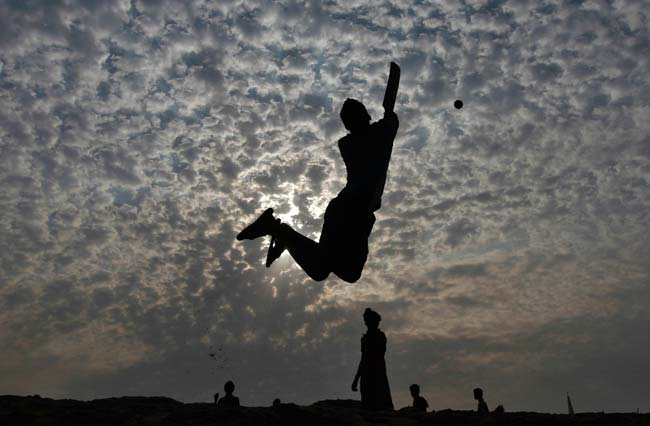 Boys play cricket on the Marina beach in the southern Indian city of Chennai.