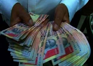 Rupee slumps to record low; bonds, stocks slump