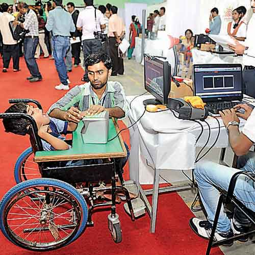 A child living with disability enrolls himself at the Model Aadhaar Enrolment Centre in Malleswaram on Thursday.
