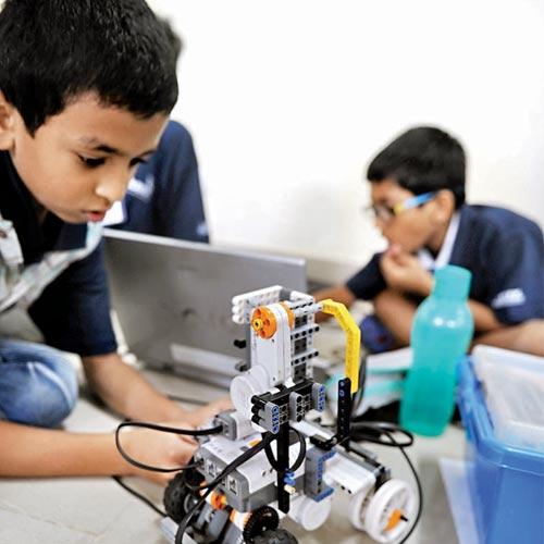 Students working on their robots at Visvesvaraya Industrial and Technological Museum for Indian Robot Olympiad on Sunday.