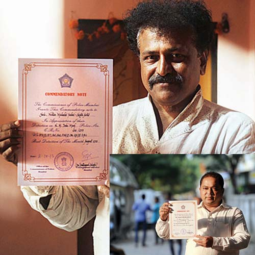 (L-R) Nitin Yadav and Siddiq Shaik display their certificates given by Mumbai police commissioner Dr Satyapal Singh on Wednesday