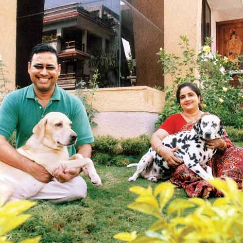Asit Ghosh with his wife and two dogs