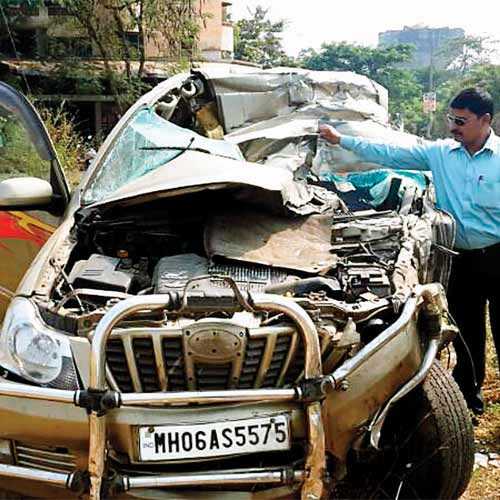 Mangled remains of the vehicle carrying the victims on Wednesday morning, near Asud village on the Mumbai-Pune Expressway.