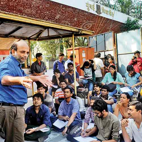 Professor Neeraj Hatekar teaches students outside the university's Kalina campus on Tuesday.