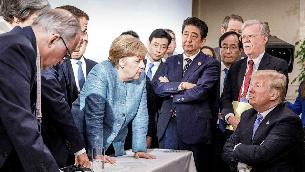 German Chancellor Angela Merkel speaking to President Donald Trump during the second day of the G7 meeting in Canada