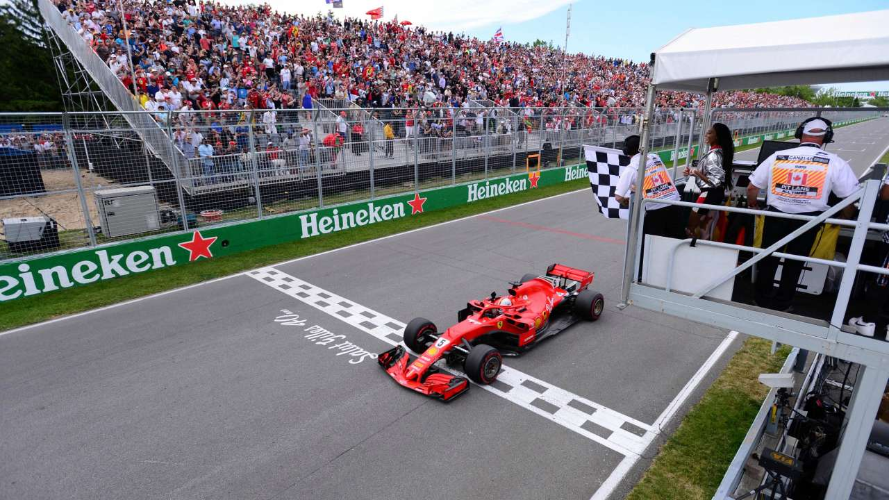 Sebastian Vettel passes the chequered flag to win the race on Sunday