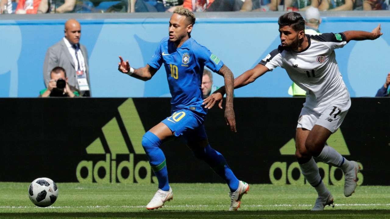 Brazil strike late for victory