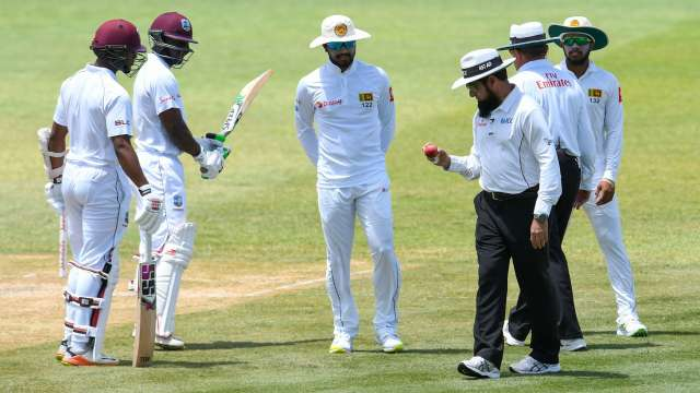 Umpire Aleem Dar has a close look at the ball during Day 3 of the second Test between Sri Lanka and West Indies on Saturday