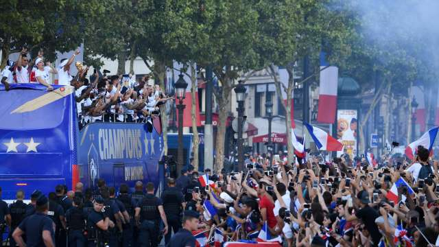 Victory Parade on the Champs Elysees after French World Cup winning football team returned home (Reuters)