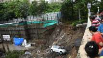 Scare for residents after wall collapses into hi-rise burying 15 cars