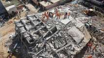 In Pics: At least three killed, several people trapped as two buildings col...