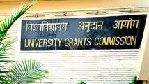In Pics: DU teachers pursuing PhD upset with UGC's notification that s...